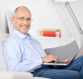 man on his laptop smiling